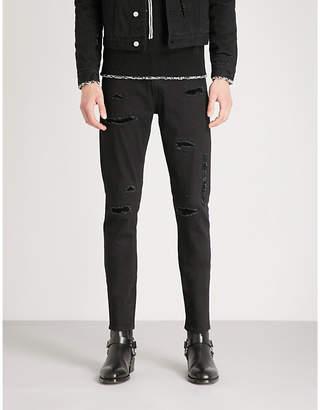 Alexander McQueen Distressed slim-fit skinny stretch-denim jeans