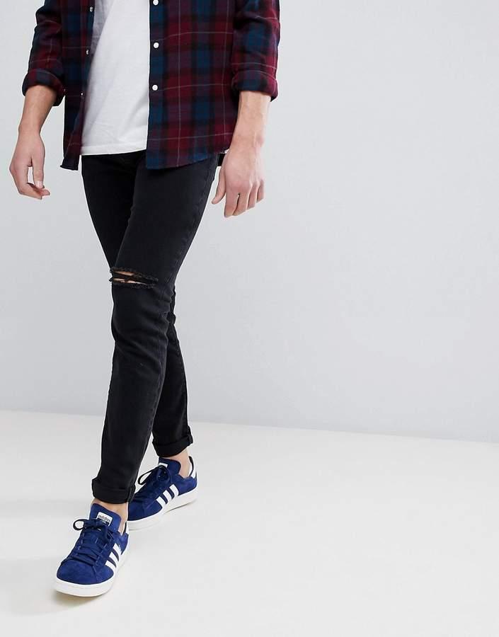 – Enge Jeans in Schwarz mit zerrissenem ...