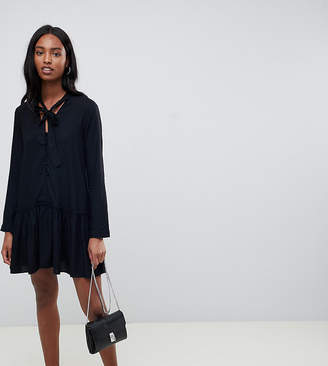 Asos Tall DESIGN Tall button front tie neck mini smock dress with long sleeves