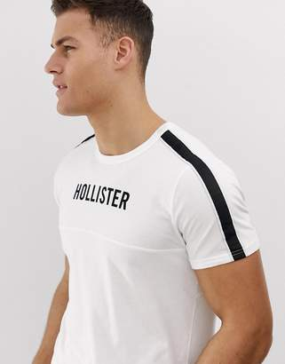 5637ec114 Hollister chest logo and sleeve taping t-shirt in white
