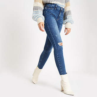 River Island Mid blue pearl button raw hem Molly jeggings