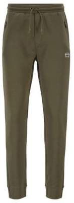 BOSS Half-cuffed jogging trousers with curved logo
