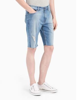 Calvin Klein destructed mid-blue cutoff denim shorts