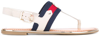 Tommy Hilfiger striped T-strap flat sandals $98.25 thestylecure.com