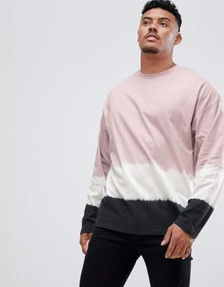 Asos DESIGN oversized longline t-shirt with dip dye in pink