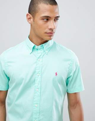 Polo Ralph Lauren Garment Dyed Slim Fit Short Sleeve Button-Down Shirt With Player Logo In Bright Green