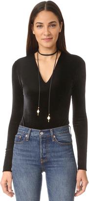 alice + olivia Lacy Velvet Bodysuit $250 thestylecure.com
