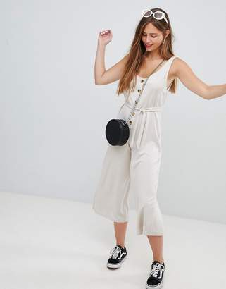 Bershka button front jumpsuit in beige