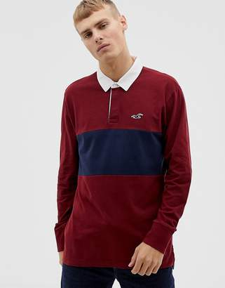 Hollister icon logo chest panel long sleeve rugby polo in burgundy/navy