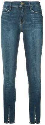 Frame ankle zip skinny jeans