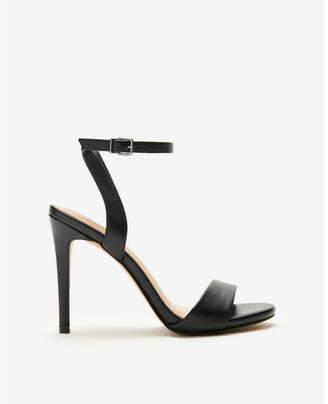 Express asymmetrical strap heeled sandals