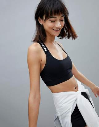 Ivy Park Active Logo Taped Stripe Bra In Black