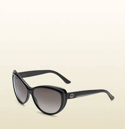 Gucci cat eye frame sunglasses with metal G Logo on temples.