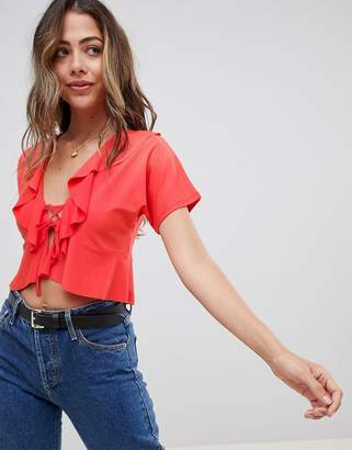Asos Design DESIGN ruffle lace up top with short sleeve