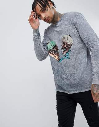 Asos DESIGN Metallica relaxed long sleeve band t-shirt with acid wash