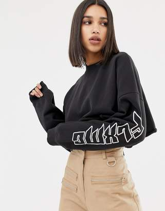 Missguided x Fanny Lyckman cropped slogan sweat in black