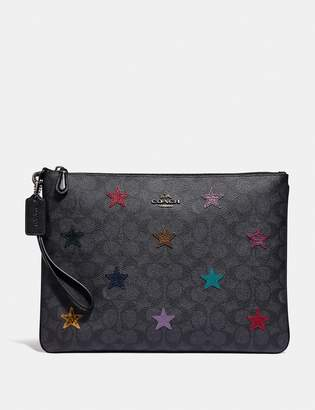 Coach Large Wristlet 30 In Signature Canvas With Star Applique And Snakeskin Detail