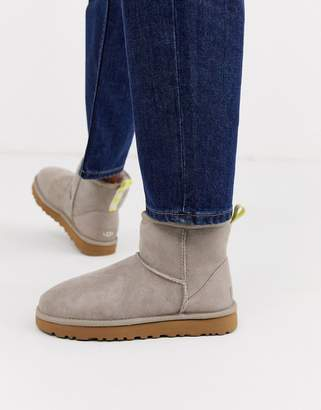 UGG Mini classic boot with neon logo taping in oyster and yellow