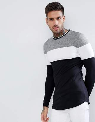 Asos DESIGN muscle fit longline long sleeve t-shirt with twisted jersey yoke panel and tipping neck