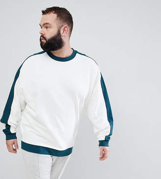 Asos DESIGN Plus Oversized Sweatshirt In White With Contrast Sleeve Panel And Ribs
