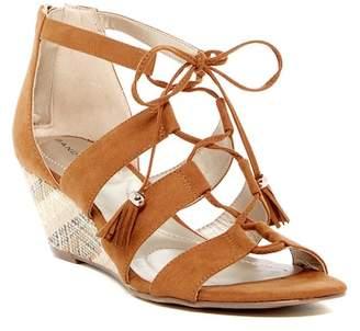 Bandolino Opiuma Woven Wedge Sandal $59 thestylecure.com