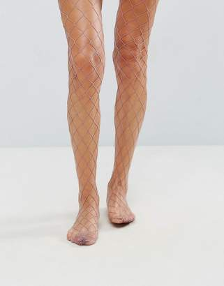 Asos DESIGN Oversized Fishnet Tights in Mauve