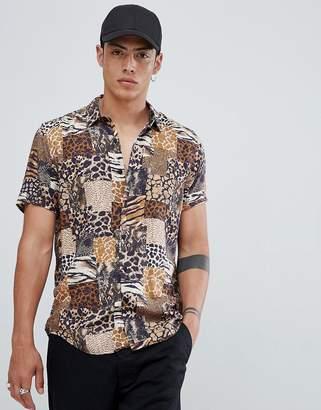 Asos DESIGN regular fit mix & match animal print shirt in brown