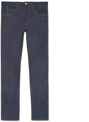 Stretch denim slim pant with tiger $860 thestylecure.com