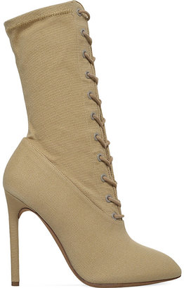 Yeezy Laced stretch-canvas heeled boots $660 thestylecure.com