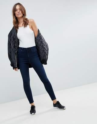Asos DESIGN Ridley high waist skinny jeans in vivienne blue black wash