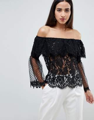 Club L Bardot Lace Top With Polka Dot Mesh Frill Sleeve Arms