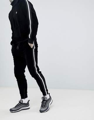 Religion skinny fit velour jogger in black with side taping
