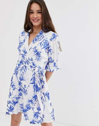 Influence wrap front dress in porcelain floral print
