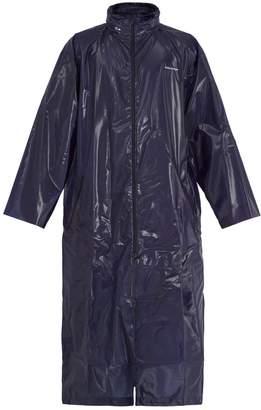 Balenciaga Self-stowing hood coated raincoat