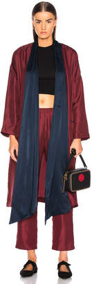 Raquel Allegra Wrap Trench in Crimson | FWRD