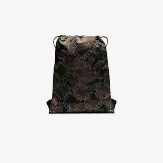 557325bf7da Valentino brown and green Garavani camo logo print drawstring backpack