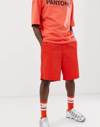 Bershka PANTONE shorts in neon orange