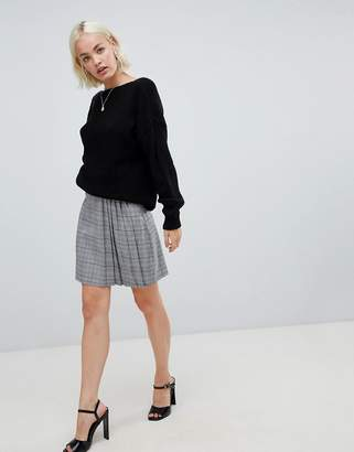 Glamorous mini skirt with pleated side in prince of wales check