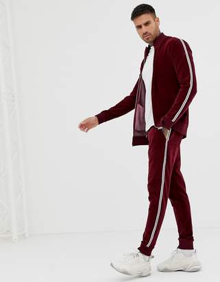 Asos DESIGN tracksuit muscle track jacket/super skinny joggers in velour with rhinestone side stripe