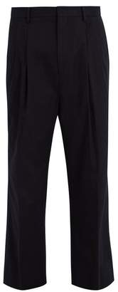 Wooyoungmi Pleated-front wide-leg stretch-cotton trousers