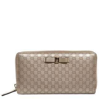 Gucci Zip Around Wallet Microguccissima Metallic Bow Golden Beige