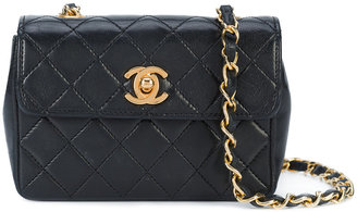 Chanel Vintage mini quilted chain crossbody bag $2,400 thestylecure.com