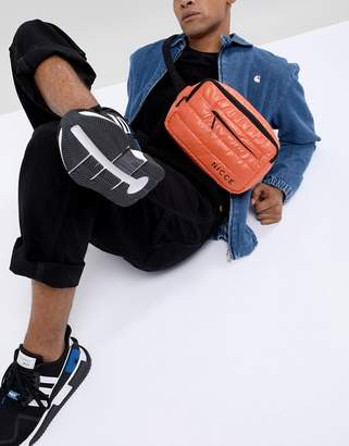 Nicce London bum bag in orange quilted