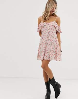 En Creme floral swing dress with cold shoulder ruffle detail