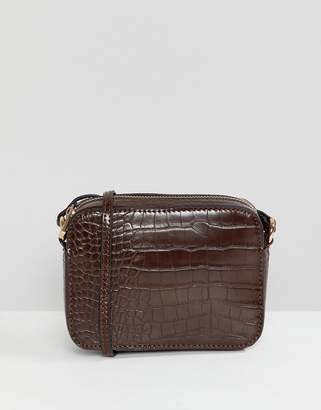 Asos DESIGN croc effect cross body camera bag