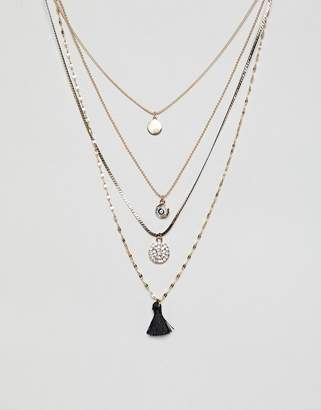 Aldo Gold Multi Layer Long Necklace With Charms And Tassel