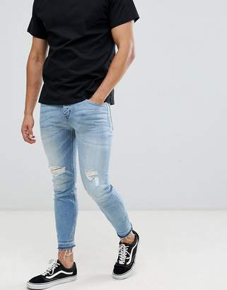 Benetton jeans in skinny fit with rip knees in light wash blue