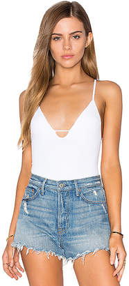 Free People Move Along Bodysuit in White $30 thestylecure.com