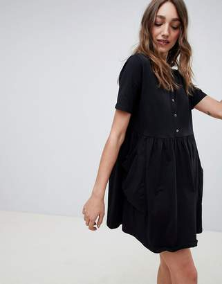 Asos DESIGN mini smock dress with pockets and button front