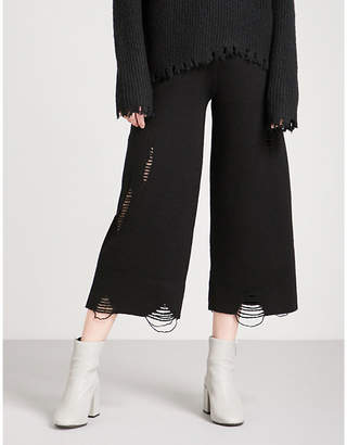 Mo&Co. Distressed wide-leg wool trousers